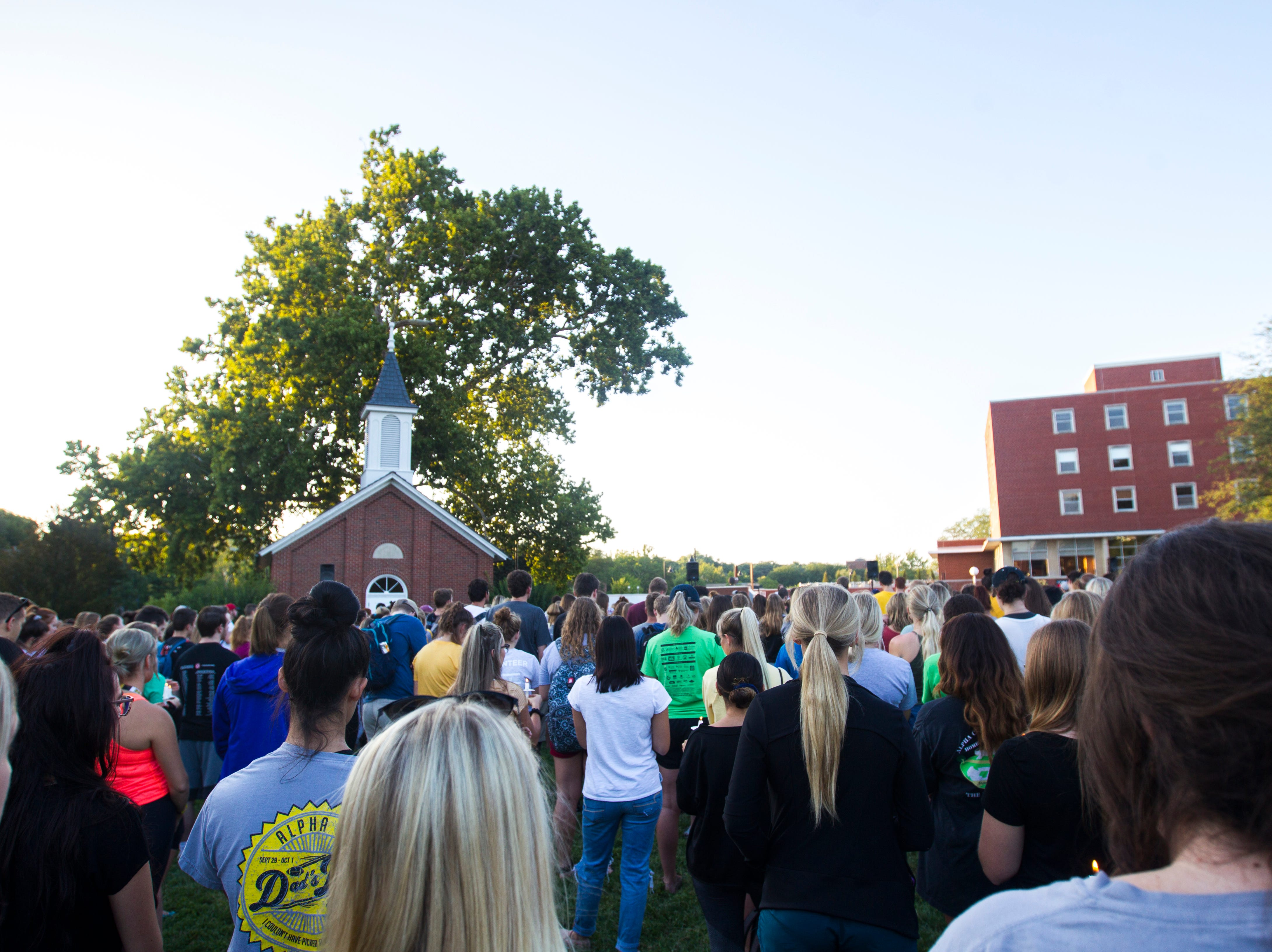 Students gather during a vigil for Mollie Tibbetts on Wednesday, Aug. 22, 2018, in Hubbard Park on the University of Iowa campus in Iowa City.