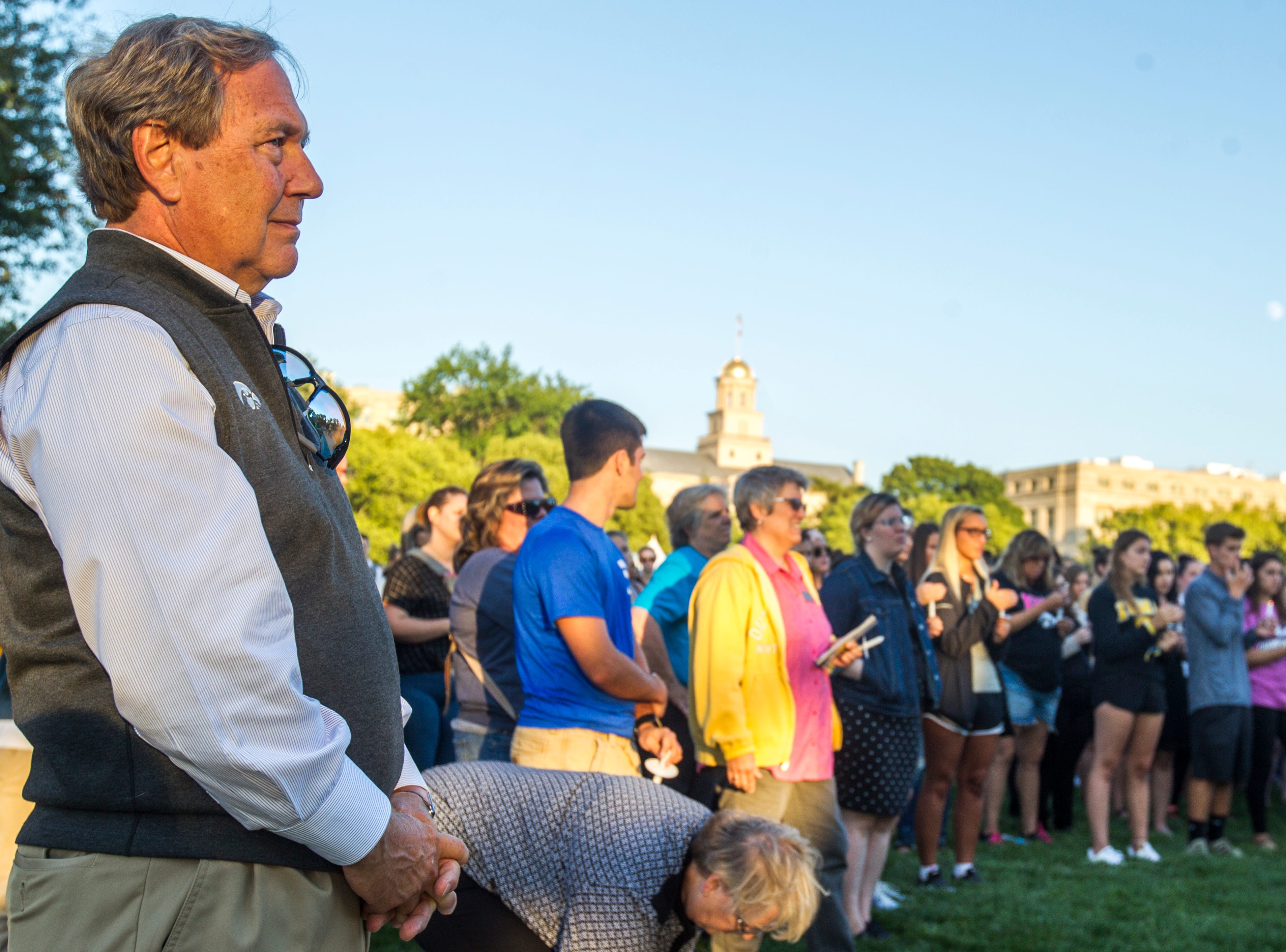 University of Iowa President J. Bruce Harreld attends a vigil for Mollie Tibbetts on Wednesday, Aug. 22, 2018, in Hubbard Park on the University of Iowa campus in Iowa City.
