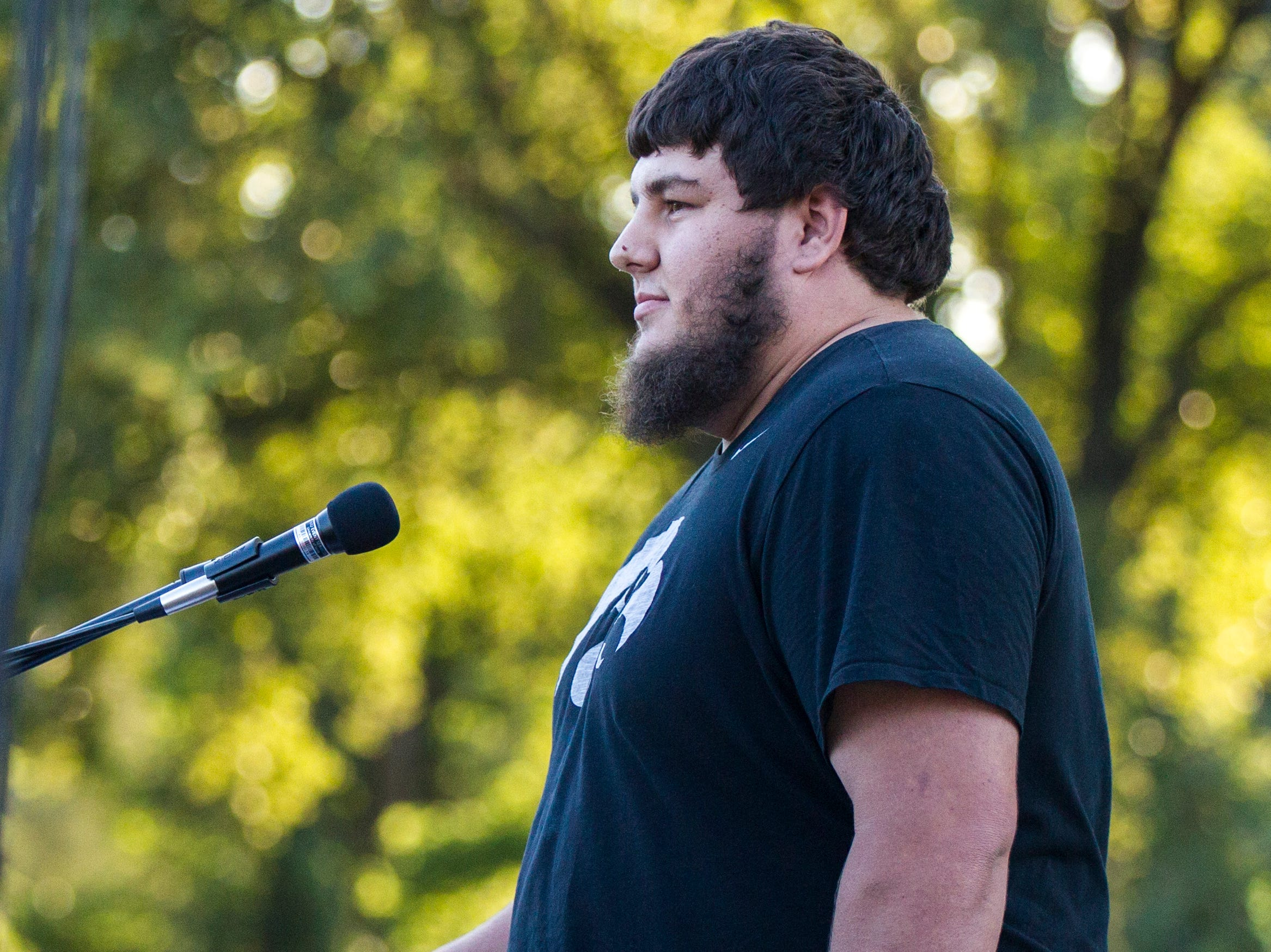 Jake Tibbetts, brother of Mollie Tibbetts, speaks during a vigil for Mollie Tibbetts on Wednesday, Aug. 22, 2018, in Hubbard Park on the University of Iowa campus in Iowa City.