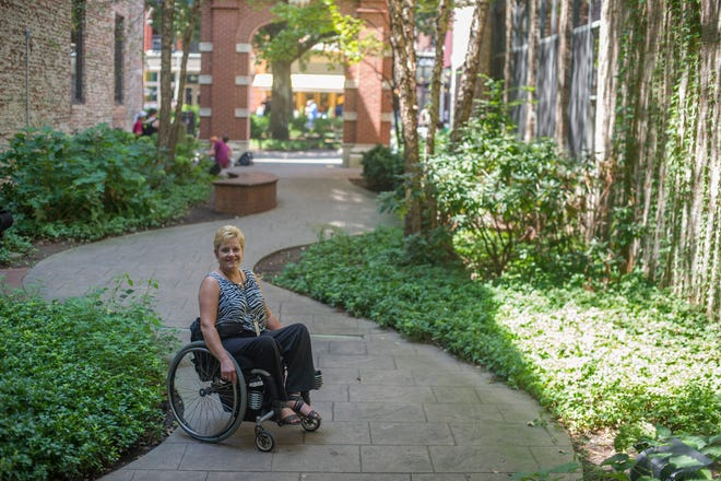 """Knoxville ADA coordinator Stephanie Brewer Cook poses for a portrait at Cafe 4 in Market Square Thursday,Aug. 13, 2015. Brewer Cook said public spaces being accessible is important because 20 percent of our population has a disability right now, not including seniors. """"If we don't have a disability today, there is a darn good chance we're going to have one before we die, so an accessible community just works for everybody,"""" she said.(JESSICA TEZAK/NEWS SENTINEL)"""