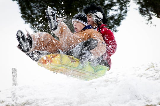 Blake Wallace, in front, and Preston Bays go sledding at Union County High School in Maynardville in 2010.