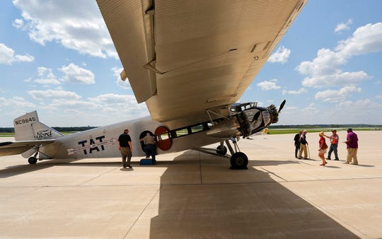 Airplane enthusiasts gather to get an up close look at a vintage Ford Tri-Motor Thursday, August 23, 2018, at Purdue Airport in West Lafayette. The plane was built in 1928 and still flies daily. Of 199 planes built, only 28 survive today.