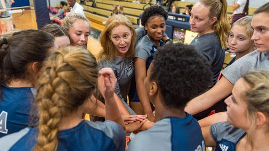 ESA Head Coach Ursula Quoyeser pre game huddle at the Volleyball Jamboree hosted by  Teurlings Catholic High School. Wednesday, Aug. 22, 2018.