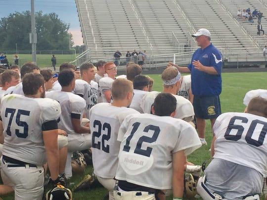 Lancaster coach Rob Carpenter, now in his 21st season coaching the Golden Gales, talks with his team after a scrimmage at Central Crossing.