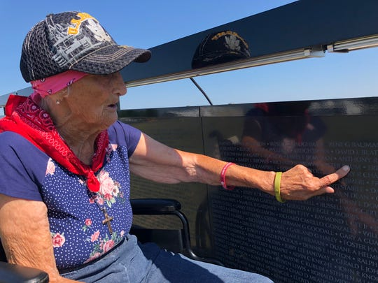 Barbara Brum, 95, points to her son's name on the Wall that Heals at the Spencer J Hardy airport in Howell.