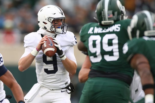 Trace McSorley of the Penn State Nittany Lions throws a first-half touchdown pass behind Raequan Williams #99 of the Michigan State Spartans at Spartan Stadium on November 4, 2017 in East Lansing, Michigan.
