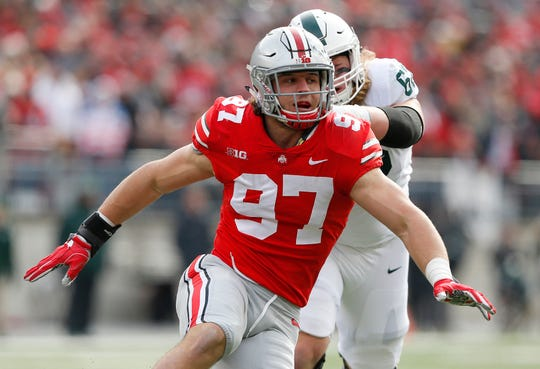 Ohio State Buckeyes defensive lineman Nick Bosa (97) rushes around Michigan State Spartans offensive tackle Luke Campbell (62) during the first half at Ohio Stadium.