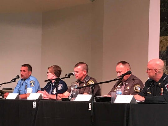 From left, Lansing Police Chief Michael Yankowski, Michigan State University Uniform Division Captain Kelly Roudebush, Ingham County Sheriff Scott Wrigglesworth, Clinton County Undersheriff Fritz Sandberg and East Lansing Police Chief Larry Sparkes speak during a police-community relations forum on Thursday, August 23. 2018 at  the Unitarian Universalist Church of Greater Lansing.