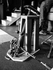 """Larry Tkaczyk's invention, dubbed """"the hammer,"""" allows Andrew Tkaczyk to drum without the use of his prosthetic leg. The device is """"genius,"""" said the drummer."""
