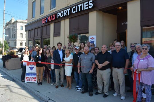 Ribbon-cutting at RE/MAX Port Cities in Manitowoc.