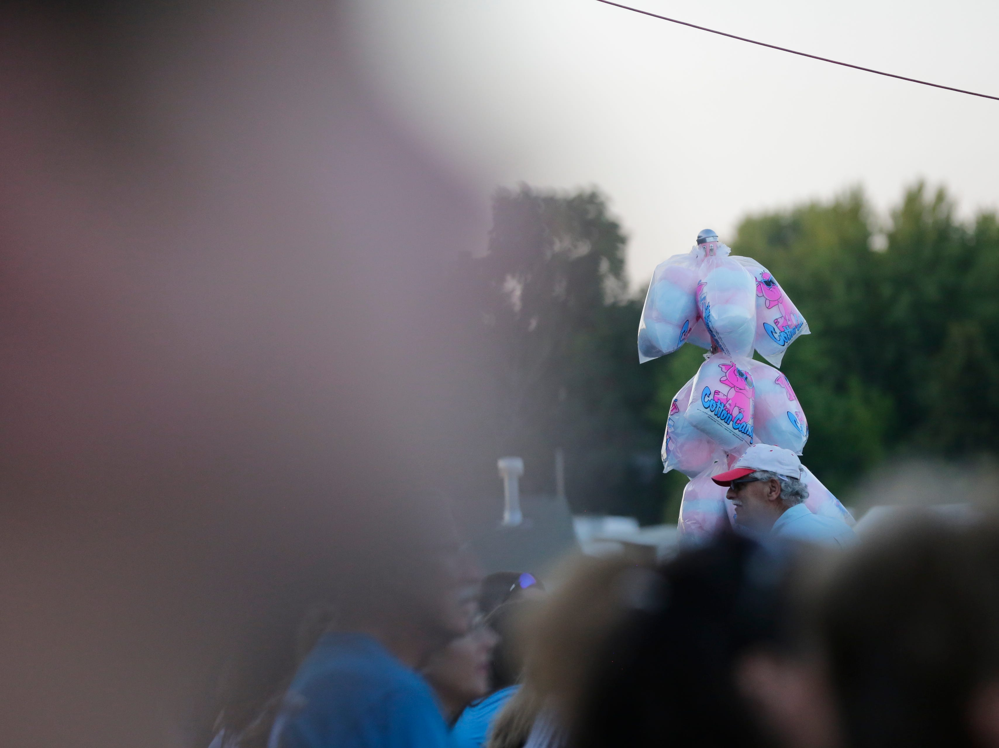 A vendor sells cotton candy during the John Michael Montgomery concert in the grandstand at the Central Wisconsin State Fair in Marshfield Wednesday, August 22, 2018.