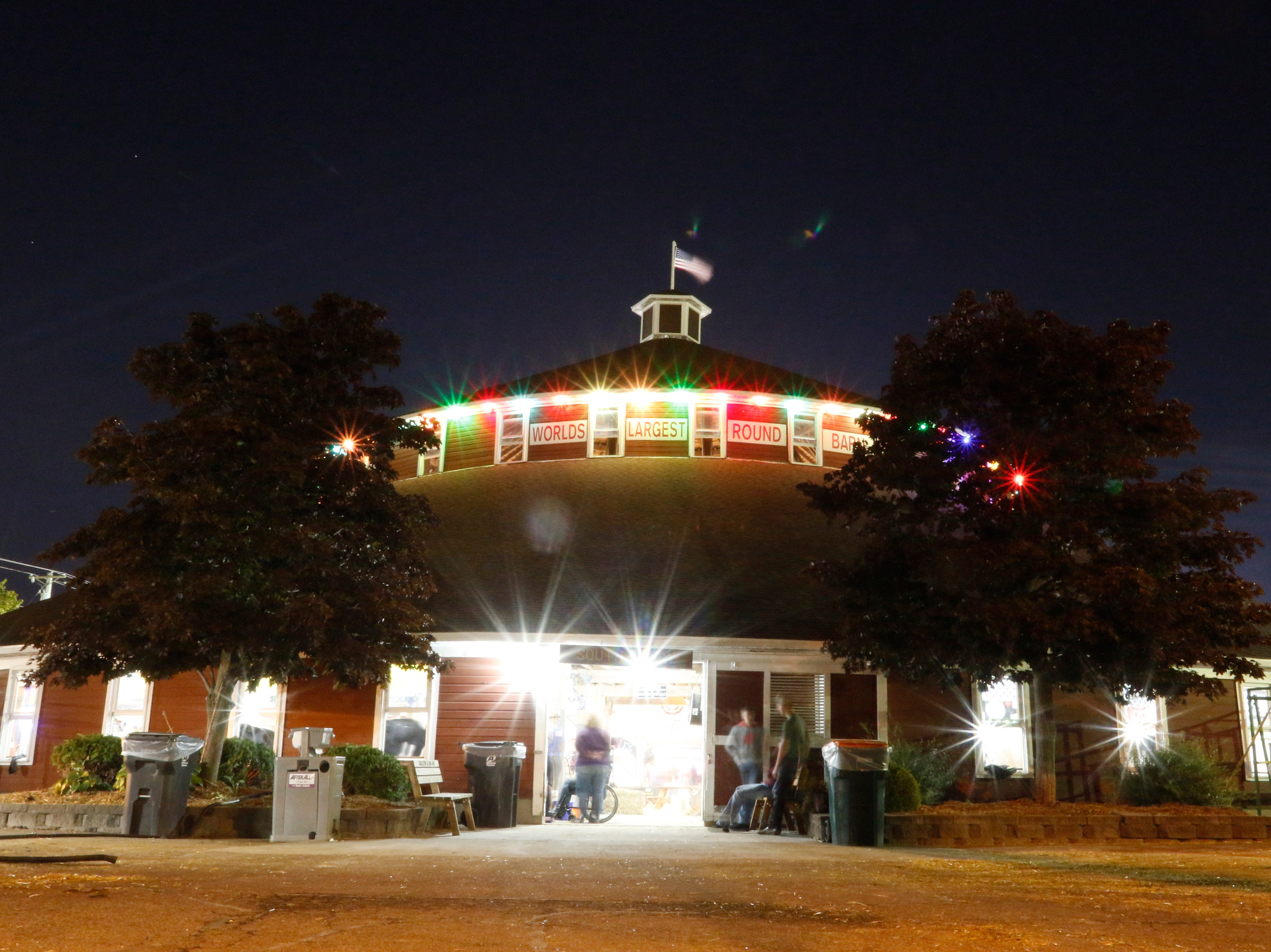 The world's largest round barn is lit with colorful lights during the Central Wisconsin State Fair in Marshfield Wednesday, August 22, 2018.