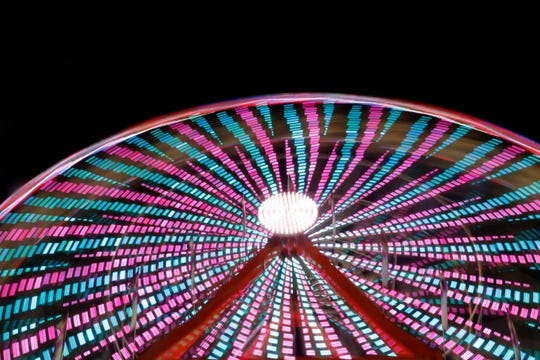 This year's Central Wisconsin State Fair in Marshfield featured an 85-foot-high Ferris wheel. The ride lit up the night sky with colors Wednesday, August 22, 2018.