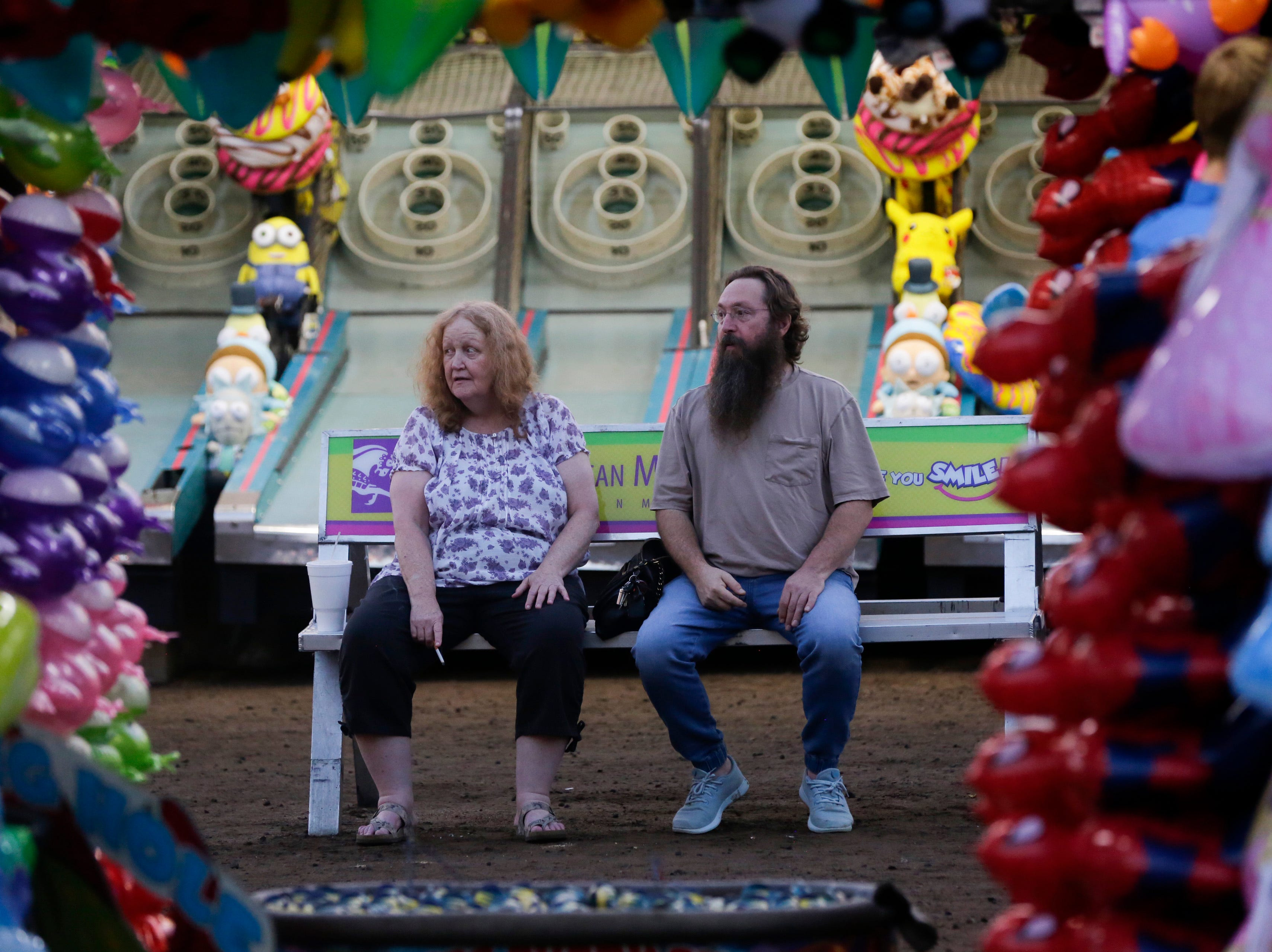Lynn and Craig Luckeroth take in the sights and sounds at the Central Wisconsin State Fair in Marshfield Wednesday, August 22, 2018.