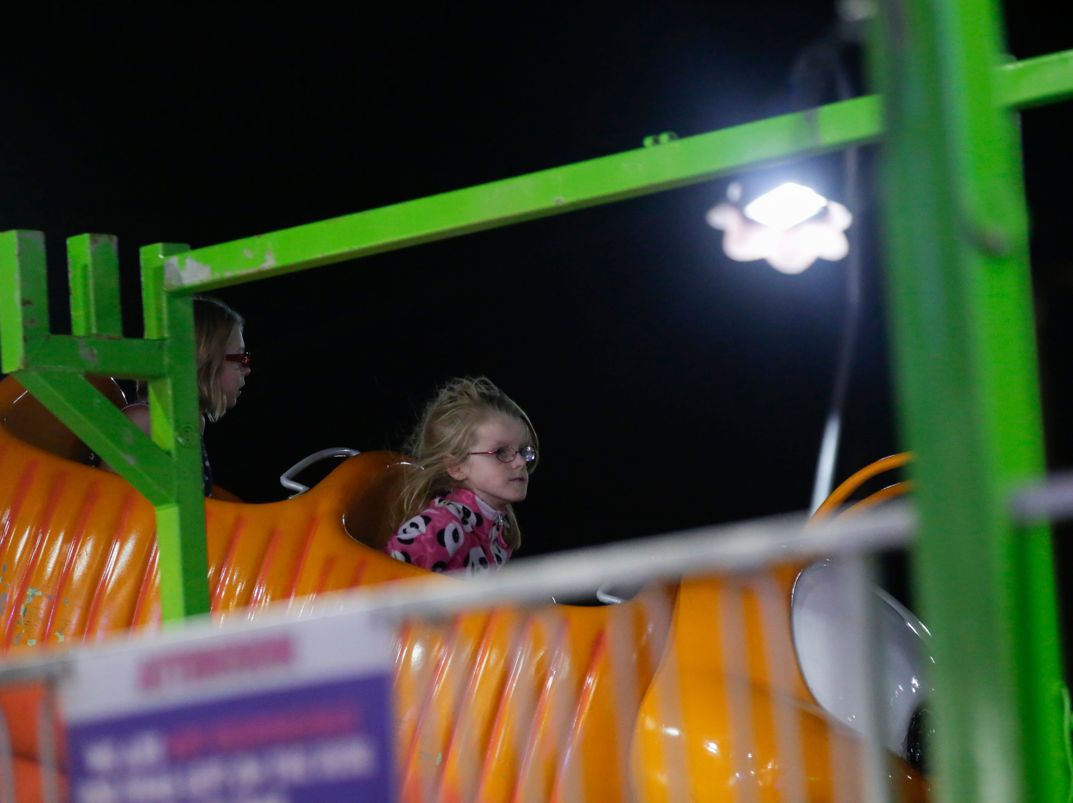 Kadence Hall, 9, rides the children's roller coaster at the Central Wisconsin State Fair in Marshfield Wednesday, August 22, 2018.