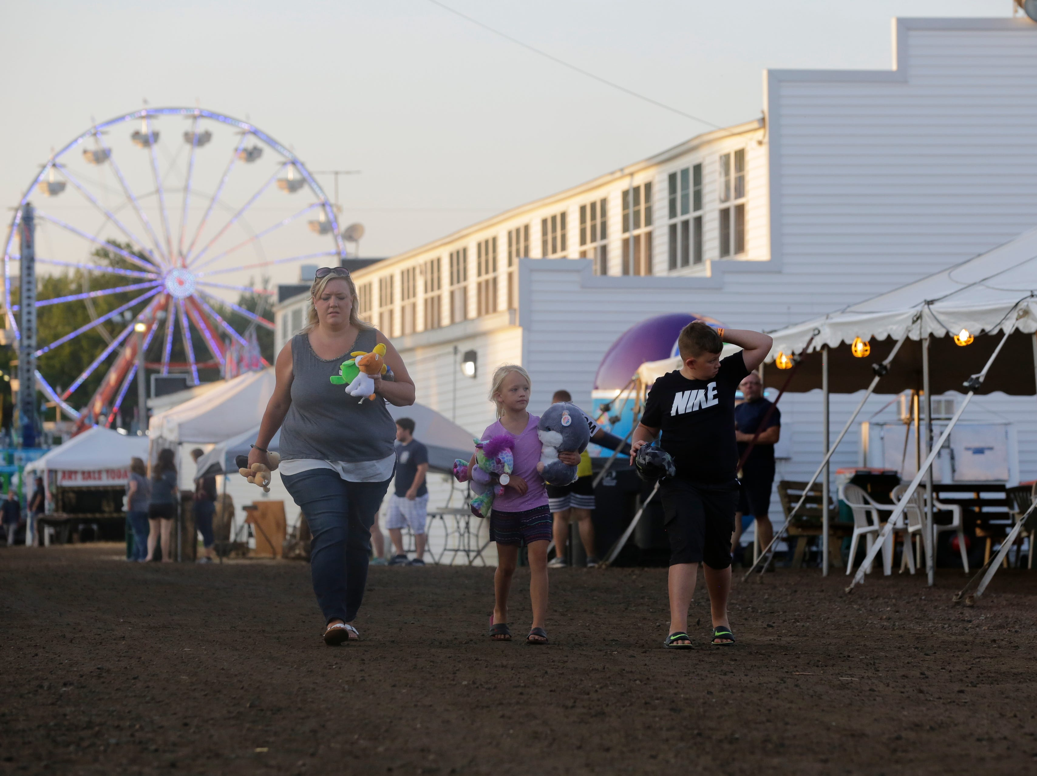 Lauren, Reagan, 6, and Peyton Karaliunas, 9, walk together at the Central Wisconsin State Fair in Marshfield Wednesday, August 22, 2018.