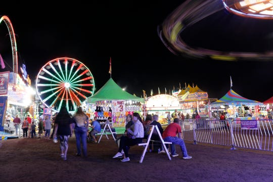 Rides fill the dark night sky with colorful lights at the Central Wisconsin State Fair in Marshfield Wednesday, August 22, 2018.