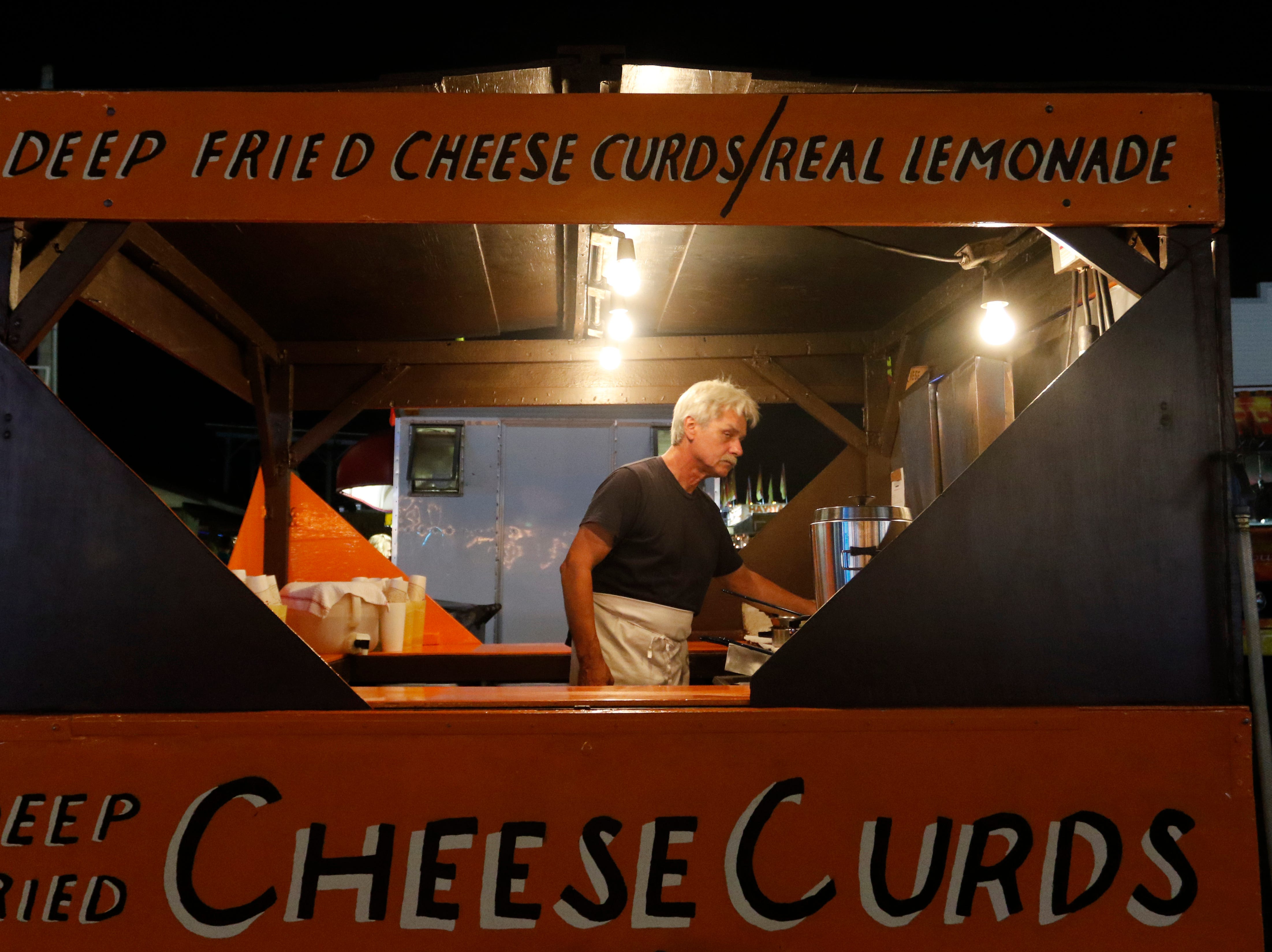 Louis Meyer works in the cheese curds and real lemonade stand  at the Central Wisconsin State Fair in Marshfield Wednesday, August 22, 2018.