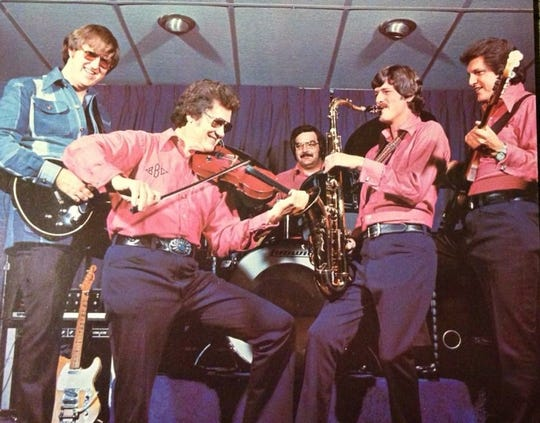"Gil Michael (second from left) and his fiddle were a key force in the successful 1970s transformation of the Bill Black Combo from a rock/R&B unit to a ""honky tonk"" instrumental ensemble."
