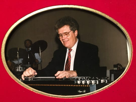 A portrait of Gil Michael and his steel guitar.