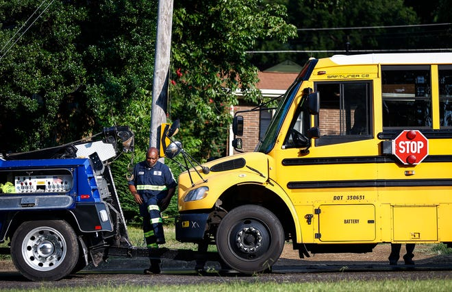A tow-truck driver loads-up a Shelby County School bus that was involved in an accident on South Perkins Road near Chuck Road, Thursday morning.