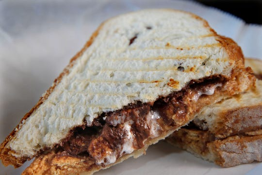You're Killin' Me Smalls sandwich is peanut butter, Nutella, graham crackers and mini marshmallows.