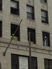 The Century Building's redevelopment project includes rebuilding the original 1925 window frames while preserving that era's window glass.