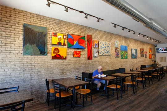 Local art is showcased on a Cream City brick wall at the Peanut Butter & Jelly Deli, in West Allis' Six Points area.