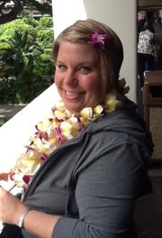 April Swick poses for a photo in Hawaii. She died Aug. 17 at age 51.