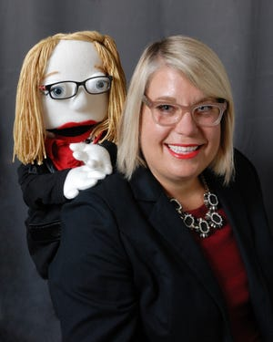 """April Swick poses with her look-alike Muppet, """"Little April."""" She died Friday."""