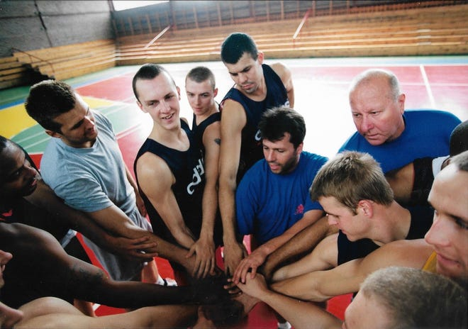 Steve Wojciechowski's professional playing career consisted of a few months with in Poland with Pekaes Pruszkow. Wojciechowski is seen on the right during a practice.