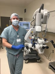 Nathan Zwagerman, a neurosurgeon at Froedtert Hospital and the Medical College of Wisconsin, stands near a microscope used for surgery in an operating room at Froedtert.