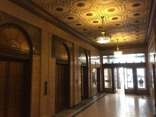 The Century Building's lobby includes a marble floor, ornate lighting fixtures and new automated elevators  — replacing the last elevators in Milwaukee that use operators.