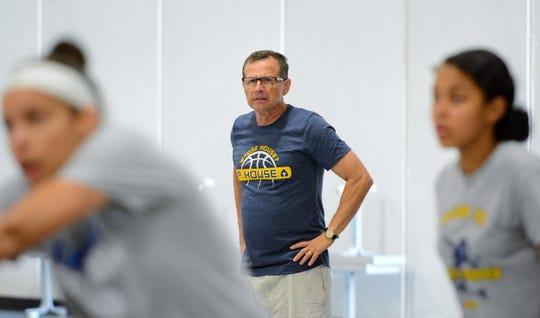 Longtime Pius XI girls volleyball coach Dave Scher leads practice Tuesday, August 21, 2018, at the high school.