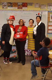 April Swick (left) dressed up every year for Dr. Seuss' birthday as the Cat in the Hat.