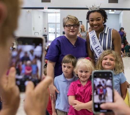 2018 Miss Louisiana Holli' Conway poses for photos with students of Lakeshore Elementary in Monroe, La. during her visit to her former grade school. Conway wanted to visit the school to encourage the children that they shouldn't give up on their dreams.