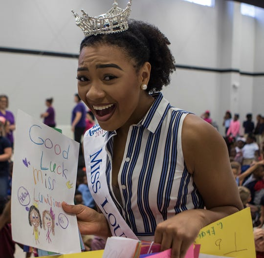 2018 Miss Louisiana Holli' Conway reacts to the outpouring of support from students at Lakeshore Elementary in Monroe, La. during her visit to her former grade school. Conway wanted to visit the school to encourage the children that they shouldn't give up on their dreams.