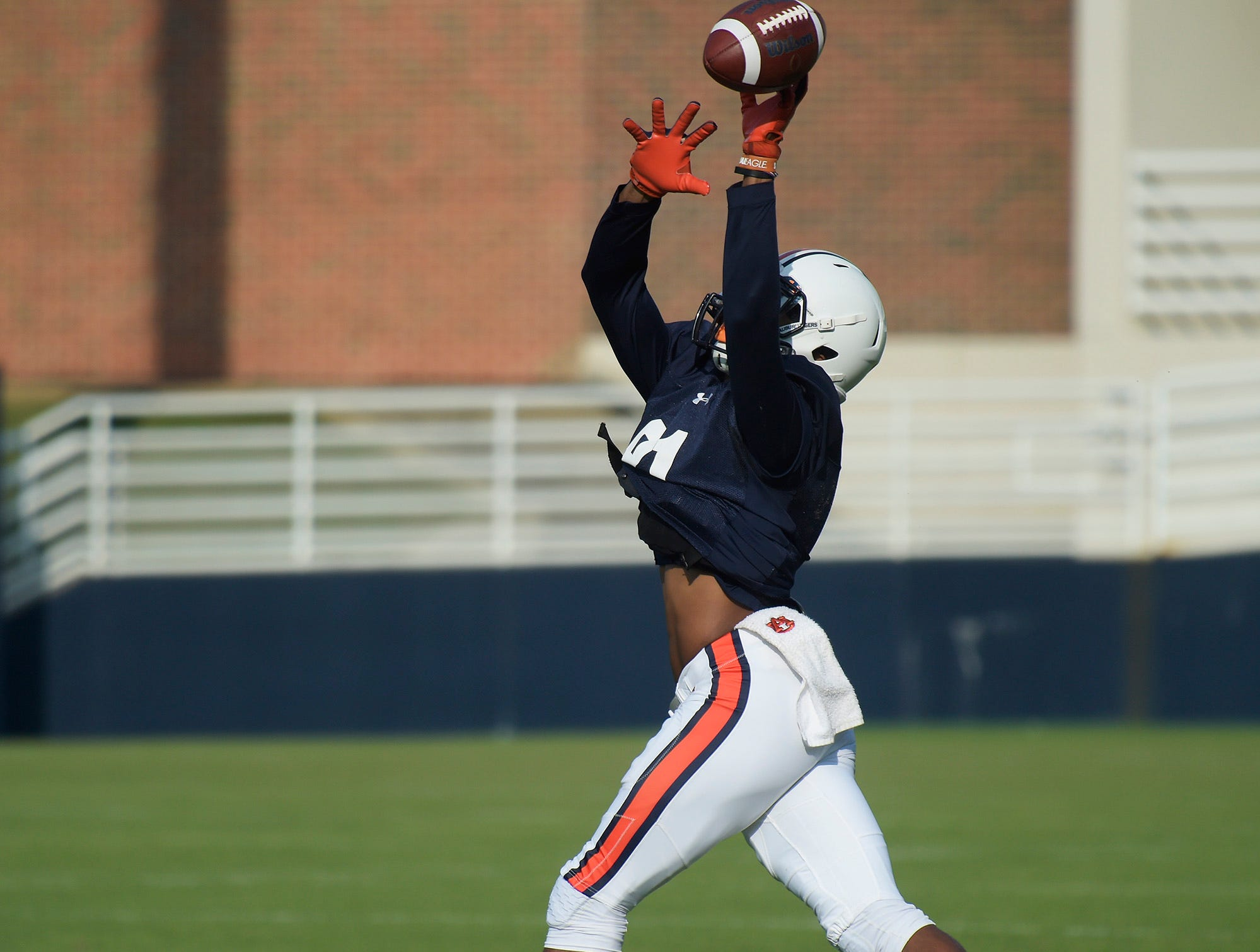 Auburn wide receiver Darius Slayton goes up to make a catch in practice on Wednesday, Aug. 22, 2018 in Auburn, Ala.