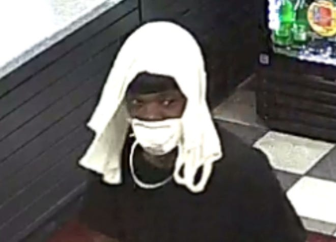 Police are seeking this man in connection to a May robbery at a convenience store on Vaughn Road.
