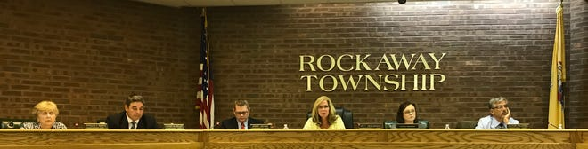 Acting Mayor Jeremy Jedynak and council members Patricia Abrahamsen, Tucker Kelley, Phyllis Smith and Victor Palumbo sit without council members John Quinn, Michael Puzio, Emanuel Friedlander and Jonathan Sackett at a Rockaway Township Council meeting.