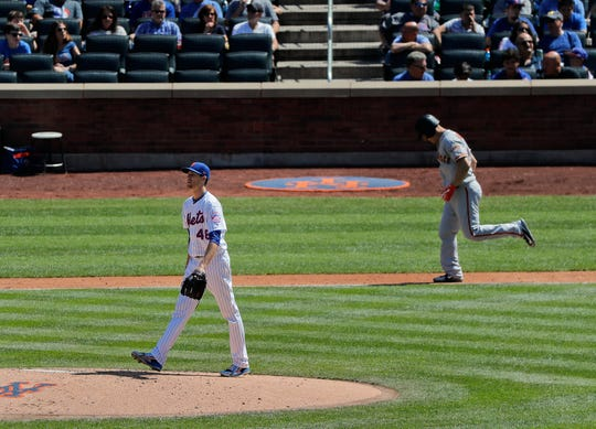 New York Mets starting pitcher Jacob deGrom (48) walks back to the mound after walking San Francisco Giants' Nick Hundley during the fourth inning.