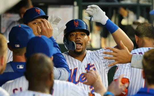 New York Mets first baseman Dominic Smith (22) is congratulated after hitting a solo home run against the San Francisco Giants during the second inning at Citi Field.
