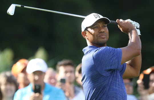 Tiger Woods hitting off the 12th tee during his first round of the Northern Trust PGA at the Ridgewood Country Club in Paramus, NJ.