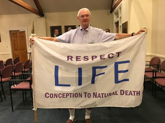 "Matthew Connell, a Westwood resident, shows his ""Respect Life"" flag he wishes to have flown at borough hall in October."