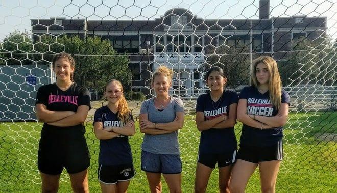 Belleville girls soccer seniors: (from left) Janelle Ramirez, Krystal Rasczyk, coach Beth Ann Garrett, Lindsey Riera and Nathalie Abreu.