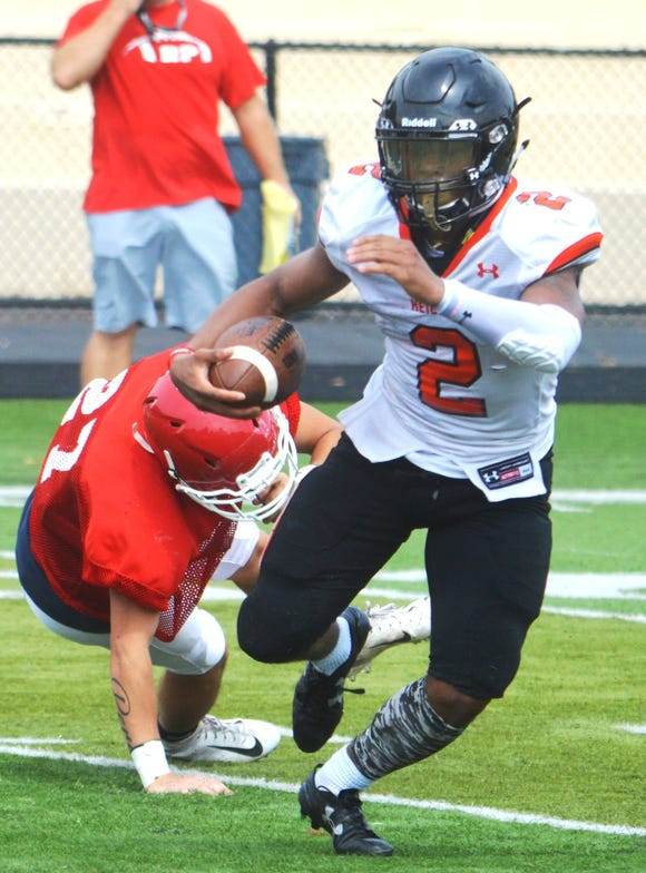 Hasbrouck Heights senior Jasiah Purdie avoiding defenders in a scrimmage against Ridgefield Park last week.