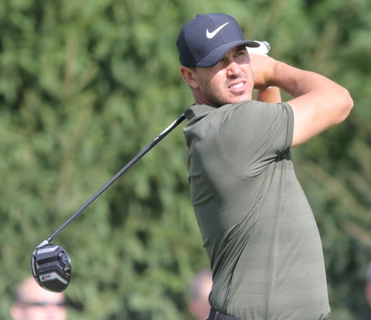 Brooks Koepka tees off from 14 during the first round of the Northern Trust PGA at the Ridgewood Country Club in Paramus, NJ.
