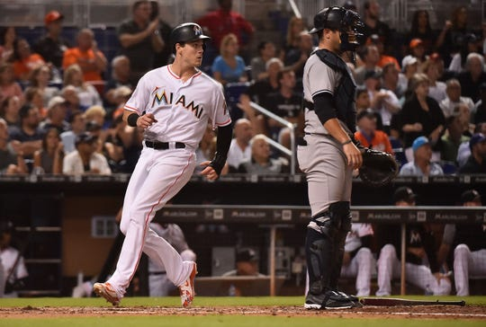 Miami Marlins third baseman Brian Anderson (15) scores in the sixth inning against the New York Yankees at Marlins Park.