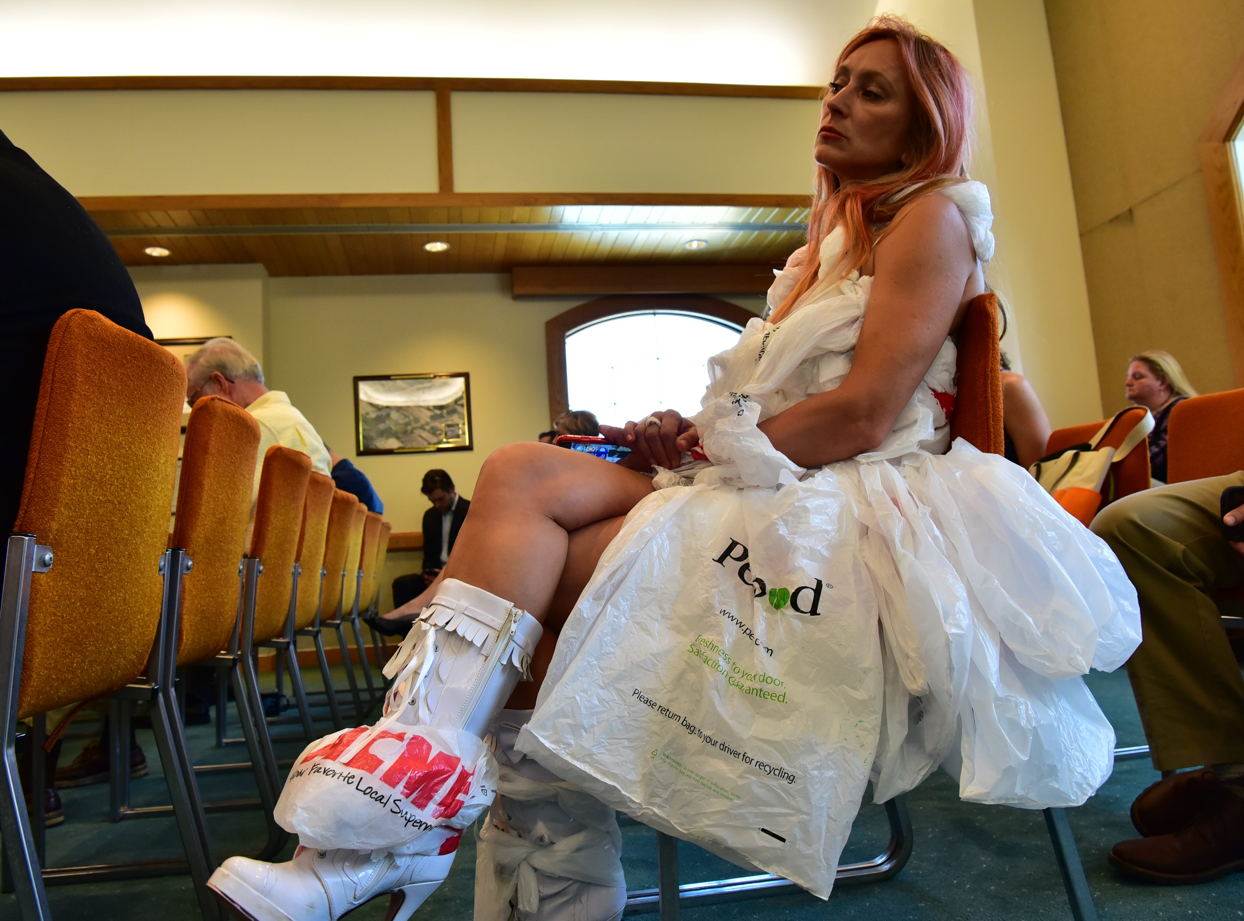 Jennifer Borenius of We Are SURE Single Use reduction Effort, wears her Plastic Monster dress at the Assembly Environment and Solid Waste Committee and the Senate Environment and Energy Committee who met on Thursday, August 23, 2018 in Toms River NJ., to hear testimony from invited guests and the public on the issues of single-use plastics and plastic waste.