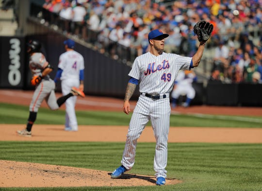 New York Mets relief pitcher Tyler Bashlor (49) reacts after giving up a solo home run to San Francisco Giants' Evan Longoria during the eighth inning.